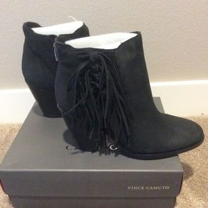 Vince Camuto Black boots with fringe detail.